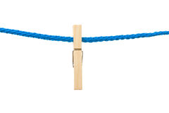 One peg. Hanging in a rope, white isolated background royalty free stock image