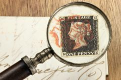 One penny black. The world's first adhesive postage stamp with red Maltese cross cancellation on entire wrapper Royalty Free Stock Photo
