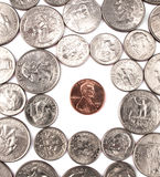 One penny coin among other coins. Stock Photos