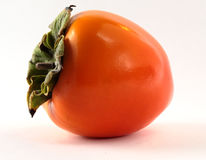 One persimmon. Persimmon - subtropical fruit well know in Russia, Eastern countries and Japan Royalty Free Stock Images