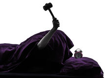One person bed smashing alarm clock silhouette. One person smashing alarm clock in bed waking up smashing alarm clock silhouette studio on white background Stock Image