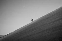 One Person Climbing Up Big Daddy Dune, Desert Landscape, Namibia Royalty Free Stock Photography