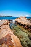 One person exploring the shores of Avoca Beach. Avoca Beach, Central Coast, Australia - November 12, 2017: One person exploring the rocky cliffs on a beautiful Stock Photos