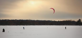 One person kiting with colorful kites in winter on snow stock photos