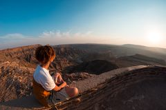 One person looking at the Fish River Canyon, scenic travel destination in Southern Namibia. Expansive view at sunset. Wanderlust t. Raveling people Stock Images