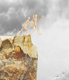 One person pushes another from a high cliff Royalty Free Stock Photography