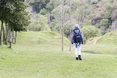 One person walking into the mountain. Royalty Free Stock Photo