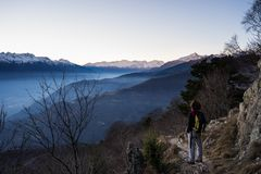 One person watching sunrise high up in the Alps Royalty Free Stock Images