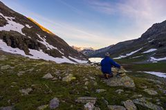One person watching sunrise high up in the Alps Stock Photo