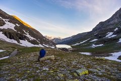 One person watching sunrise high up in the Alps Royalty Free Stock Photo