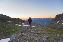 One person watching sunrise high up in the Alps Stock Images