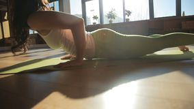 One personal trainer doing asanas lie down on matting