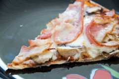 One piece of bacon pizza Royalty Free Stock Image