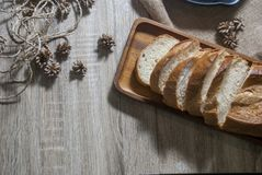One piece of baguette cut into pieces on a wooden tray from the top view royalty free stock photos
