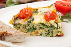 One Piece of Kale Tomato Frittata Royalty Free Stock Photo