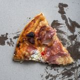 One piece of pizza in cardboard pizza box. Royalty Free Stock Photos
