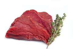 One Piece raw Beef Tenderloin with a twig Thyme Royalty Free Stock Photos