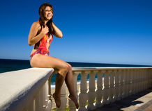One piece swimsuit on a rail Royalty Free Stock Image