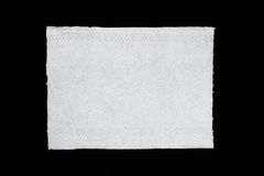 One piece of tissue paper isolated on black Stock Images
