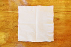 One piece of tissue on wooden table Royalty Free Stock Photos