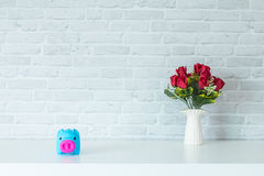 One piggy bank savings. The One piggy bank On a white table For savings Royalty Free Stock Images