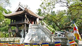One Pillar Pagoda is a historic Buddhist temple in Hanoi, Vietnam. People can seen exploring around it. stock footage