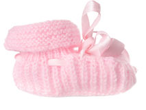 One pink baby bootee with a bow. Isolated on a white background Royalty Free Stock Image