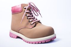 Kids boot over white. One pink children`s female boot over white Royalty Free Stock Photos