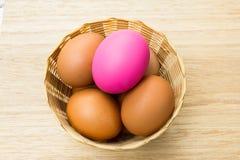 Eggs in basket Stock Photos
