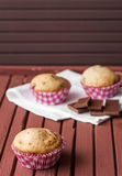 Muffin in the brown table. One pink muffin in the brown table royalty free stock image
