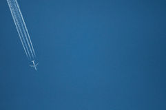 One plane fly on blue sky background Royalty Free Stock Photography