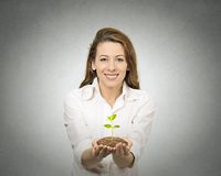 One plant in female hands Royalty Free Stock Photo
