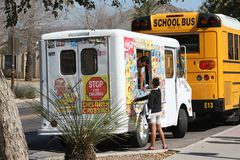 USA, Arizona: Ice Cream Truck >This one, please!. An ice cream truck - a vintage Chevrolet-, sounding its jingle, attracts a customer. A girl points to the ice Stock Photos