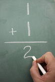 One plus One equals Two on Blackboard Stock Photography