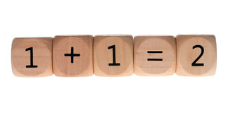 One plus one. Wooden cube with one plus one equals two isolated over a white background Stock Photography