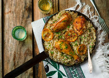 ONE POT GREEK CHICKEN and LEMON RICE. Selective focus Stock Photos