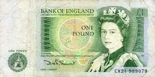One pound bank note. The old British green paper one pound note that has been replaced by the one pound coin royalty free stock photography