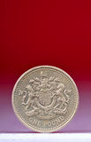One pound coin. Isolated over colored background Royalty Free Stock Image