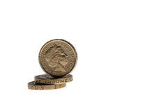 One pound coins on the edge isolated Stock Photography