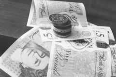 One Pound Coins and New 5 Pound Notes BW Stock Photography