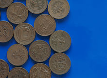 One Pound GBP coin, United Kingdom UK over blue with copy sp. Many One Pound GBP coins, currency of United Kingdom UK over blue background with copy space Royalty Free Stock Photo