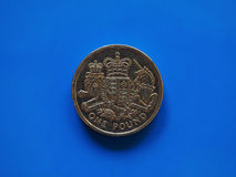 One Pound GBP coin, United Kingdom UK over blue Royalty Free Stock Images