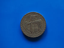 One Pound GBP coin, United Kingdom UK over blue. One Pound GBP coin, currency of United Kingdom UK over blue background Royalty Free Stock Photos