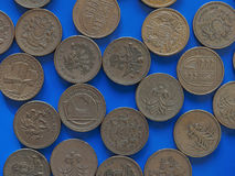 One Pound GBP coin, United Kingdom UK over blue. Many One Pound GBP coins, currency of United Kingdom UK over blue background Stock Image