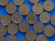 One Pound GBP coin, United Kingdom UK over blue. Many One Pound GBP coins, currency of United Kingdom UK over blue background Royalty Free Stock Photo