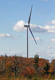 One power generating wind turbine autumn colors Stock Image
