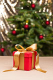 One present with gold ribbon Stock Photos