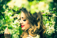 One pretty girl in the garden under the blossom tree Stock Photos