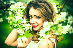 One pretty girl in the garden under the blossom tree Stock Photo