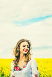 One pretty girl walkin in the yellow field with blue sky Royalty Free Stock Images